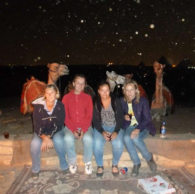 Women Expats in Cairo Egypt at night with camels and pyramids