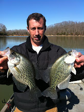 Photo: Feb. 26, 2012 - Brad Hudson shows off a pair of bragging-sized crappie.