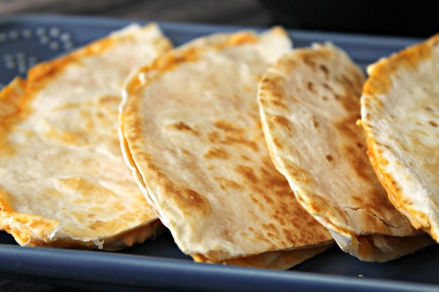 Buffalo Chicken Quesadillas are quick and easy to make. Buffalo sauce, ranch dressing, cheese & chicken, spread over tortillas and cooked until golden brown.
