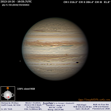 """Photo: I took this image of Jupiter with two moons and one shadow this past Saturday morning with my 14"""" f/4.5 Newtonian.  I like the way I processed this one from this past Saturday morning. The moon Europa is off the edge of Jupiter on the left. The round, orange dot to the right and lower of center is the moon Io. The dark oval-shaped spot is the shadow of Europa. The shadow is falling towards the limb of Jupiter and because of the angles of the shadow it becomes more and more oval shaped the closer to the edge it gets.  #Astronomy  #Planetary  #astrophotography  #Jupiter  #solarsystem"""