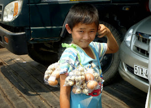 Photo: This young boy was selling assorted eggs on our ferry ride across the delta to Long Xuyen.