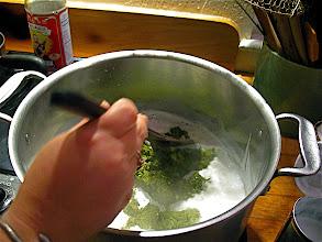 Photo: frying paste in coconut cream