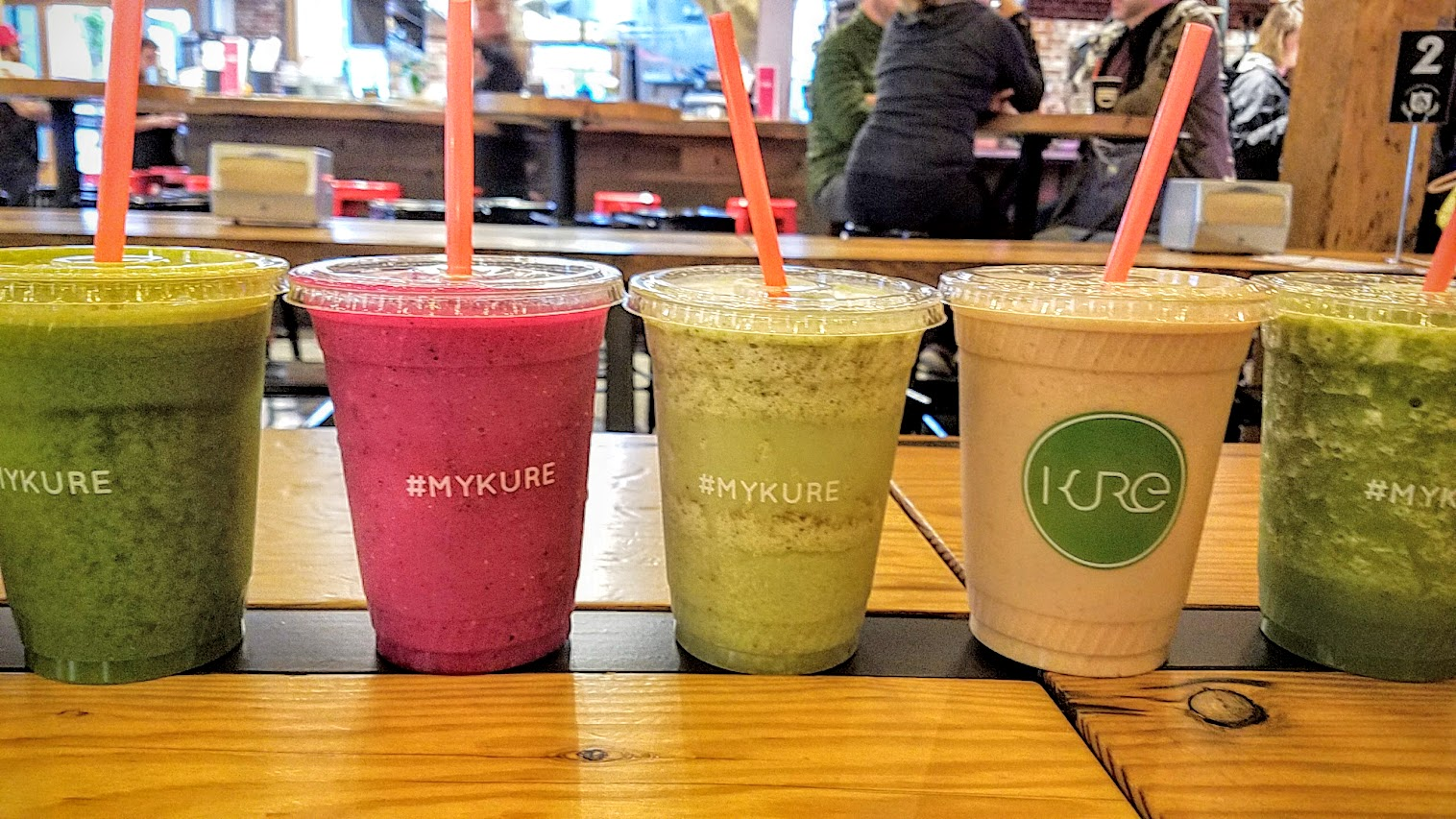 For a healthy option during lunch or brunch at Pine Street Market, Kure Juice Bar offers organic juices, smoothies, tonic shots, hot beverages, oatmeal, and açai bowls