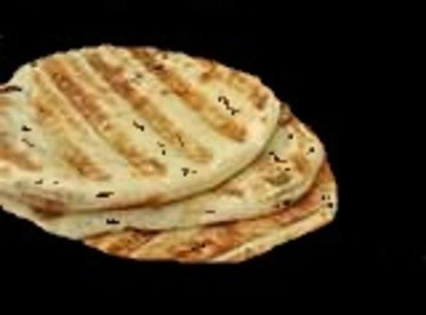 Lightly brush olive oil on both sides of pita breads