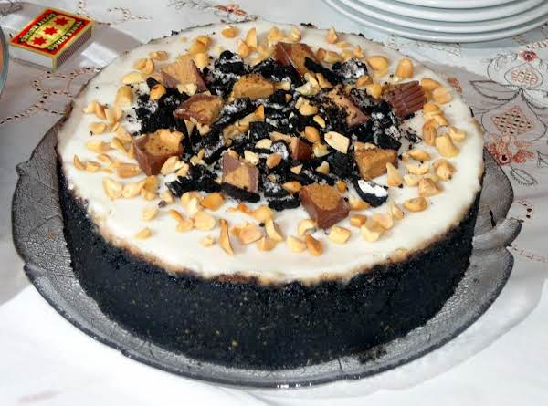 Reese's Peanut Butter Cup Cheesecake With Oreo Crust And Toasted Peanuts.