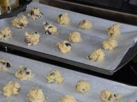 Preheat oven to 350. Line two cookie sheets with parchment paper.  Whisk flour, sugar, and...