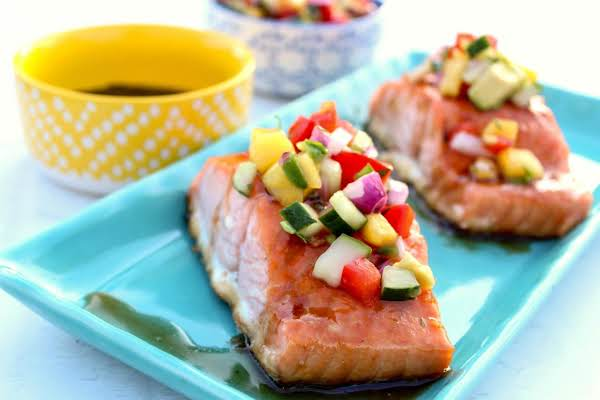 Two Salmon Pieces With Mango Salsa And Maple Glaze.