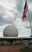 Photo: Entering Epcot  The storm clouds were looming, preparing for the typical Florida summer thunderstorm. As I waited outside Epcot for my friend to arrive, I snapped a few shots.  I love the flag in the foreground with Spaceship Earth rising up in the background. I only wish it were a prettier day.  Tags: #WDW #WaltDisneyWorld #Epcot   #SpaceshipEarth #WDWPhotoFriday   #DisneyPics   Full Size Version on Flickr: http://flic.kr/p/d3hc5j