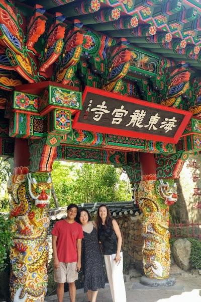 Students standing beneath ornate architecture while on Study Abroad Program in Daegu S. Korea