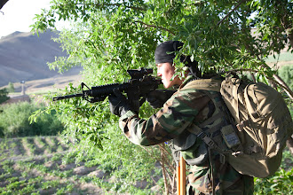 Photo: An Afghan National Army Commando from the 6th Commando Kandak, pulls security in an almond orchard in Wardak Province, Afghanistan, on June 14, 2011. The commandos, assisted by U.S. Army Special Forces Soldiers, searched a village in the Province for weapons caches and high value Taliban targets.  (U.S. Army Photo by Staff Sgt. William H. Newman) (Released)