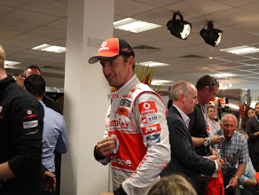 Photo: This is apparently Jenson Button. He drives a car.