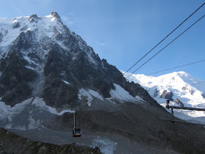 """Photo: The cable-car or """"telepherique"""" starts right in town and climbs to a midway station. From there it runs up a single uninterrupted span of cable all the way to the top, ascending about 9,000 ft total in 20 minutes. Quite impressive!"""