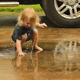 Paying in the rain! by Ron Olivier - Babies & Children Children Candids ( paying in the rain!,  )