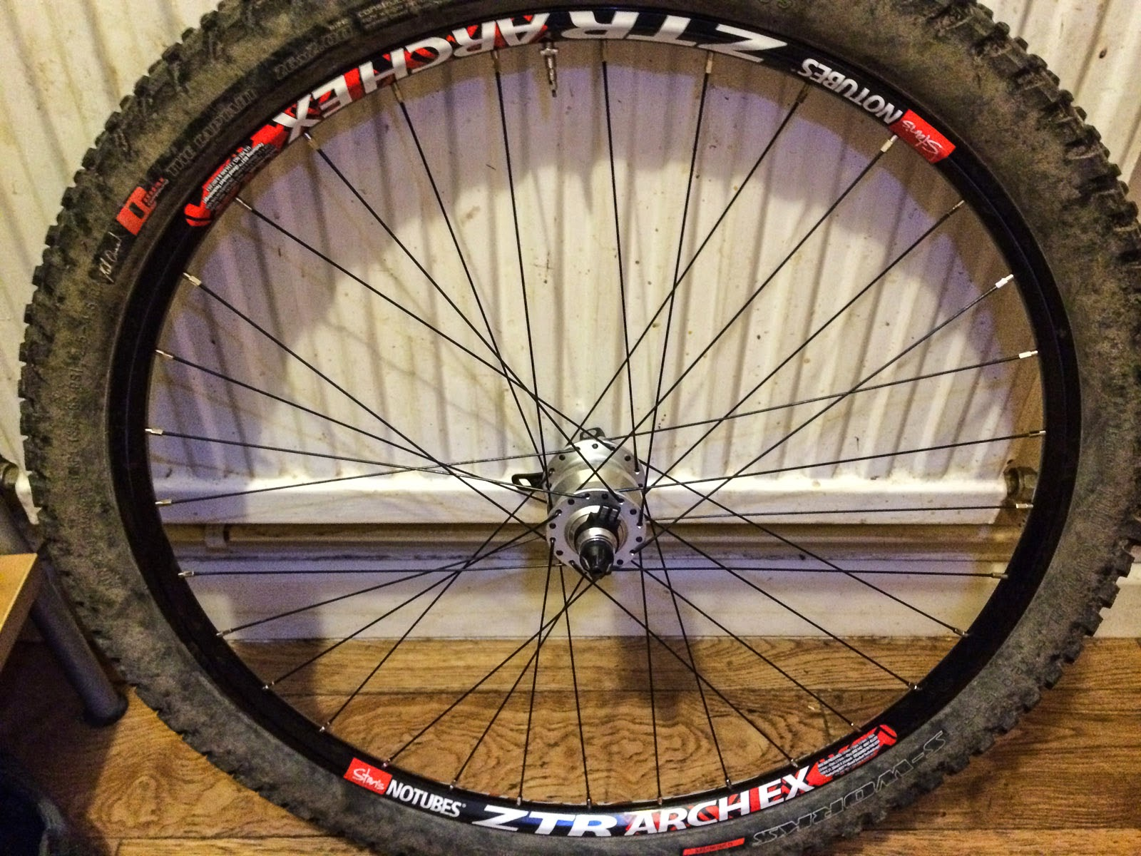 Photo: the finished wheel fitted with some dirty ol' rubber!
