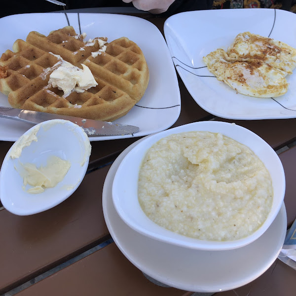 GF waffle with fried eggs and grits