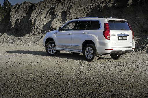 The rear with its vertical light clusters is similar to the Toyota Prado.