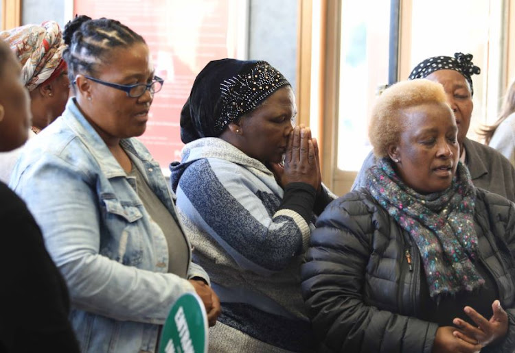 Women enter the Clareinch Post Office in Claremont in the Western Cape to remember UCT student Uyinene Mrwetyana who was raped and killed there.