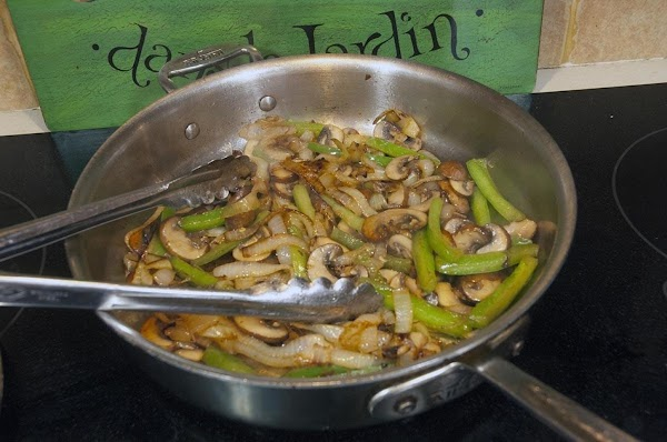 Continue to sauté until the onions are brown and the peppers and mushrooms are...