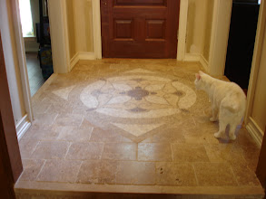 Photo: entry way medallion in the center, surrounded by 6x6 Turkish tiles  in brick pattern. finished and approved by kitty.