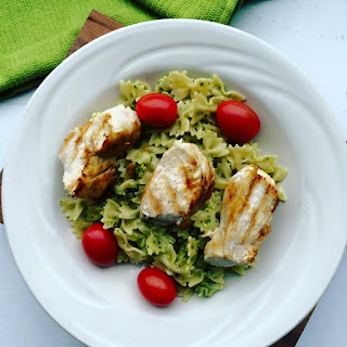 Avocado Pesto Pasta with Grilled Chicken and Cherry Tomatoes.