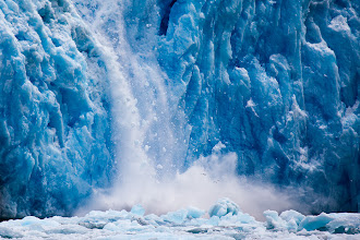 Photo: This is a quick shot of a calving glacier in Alaska. If you look closely at the larger version you can see a couple of birds fleeing the scene to get a sense of scale.  Shortly after this the entire face of the glacier collapsed. It was quite a site to see. The scale of the amount of ice falling is so large that it actually isn't as impressive as this smaller flow in a photo. The large scale ones really need a video to tell the story.