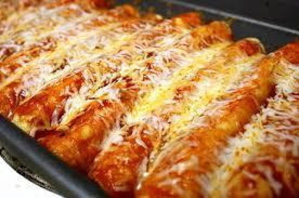 For enchiladas, heat oven to 350 degrees. Heat about 1/2-inch vegetable oil in a...