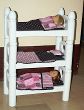 Photo: The girls' triple bunk Christmas present for the baby dolls. Our girls sleep in a triple bunk bed, so they thought it was great that their dolls will also sleep on a triple bunk bed. The quilts and pillows were made by Becca.