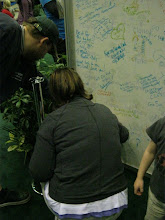 Photo: At the Expo, writing on the good luck wall thing.