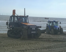 Photo: The lifeboat just offshore, in contact with Humber coastguard during the training. The Cat dwarfing quite a substantial tractor used for towing the zodiac and equipment trailers.