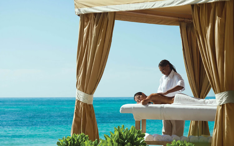Enjoy a massage at beachside at the Grand Lucayan Beach & Golf Resort.