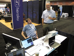 Photo: Min and Brian while we were setting up. We got an excellent spot, right by the entrance, across form Heroku and Google (behind Brian).