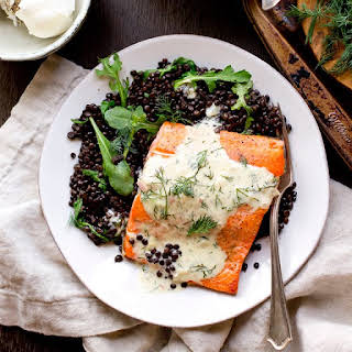 Salmon with Dill Sauce and Beluga Lentils.