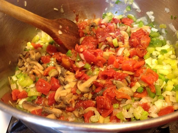 Add the diced tomatoes & sliced mushrooms to the pot.  Stir to mix...
