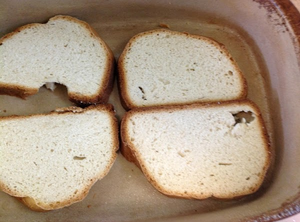 "Slice bread into 8-1/2"" thick slices and put in the bottom of a deep..."