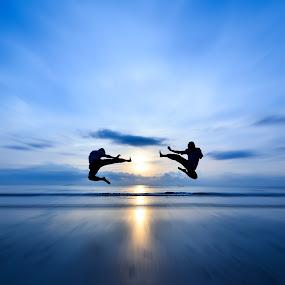Flying Kick VS Flying Kick by Shahril Khmd - People Street & Candids ( flying, kick, sunset, ocean, sunrise, silhouette )