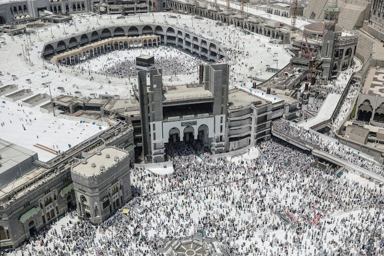 Muslim pilgrims walk out after the Friday prayer at the Grand mosque ahead of annual Hajj pilgrimage in the holy city of Mecca, Saudi Arabia August 17, 2018.