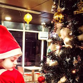 Baby santa by Nishant Mishra - Babies & Children Children Candids ( wish, red, mobilography, innocence, baby, mobile photos, christmas, santa )