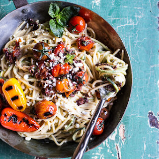 20 Mediterranean Hummus Noodles with Blistered Cherry Tomatoes.
