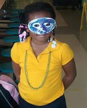 Photo: Kaleya wears her mask