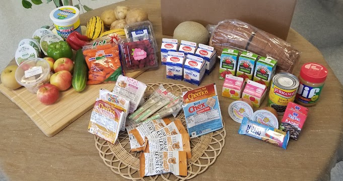 Sample meal box (each box meets USDA meal pattern equivalents for 7 days of breakfast & lunch, plus 5 days of afterschool supper).  This institution is an equal opportunity provider.