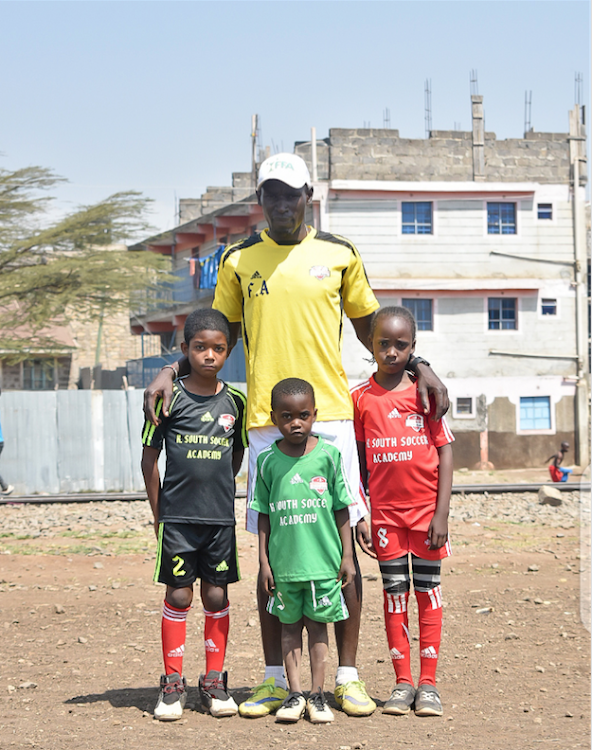 Coach Fred Odhiambo poses with some of his young players