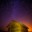 Home of Stars by Mladen Bozickovic - Landscapes Starscapes ( home, sky, lighting, nature, grass, stars, outdoor, house, architecture )