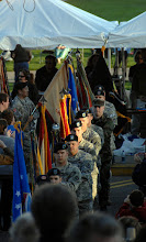 Photo: A colof guard representing every battalion and wing in the Minnesota National Guard marches to the stage during a ceremony held in front of Capitol Building for Minnesota State's Sesquacentennial.