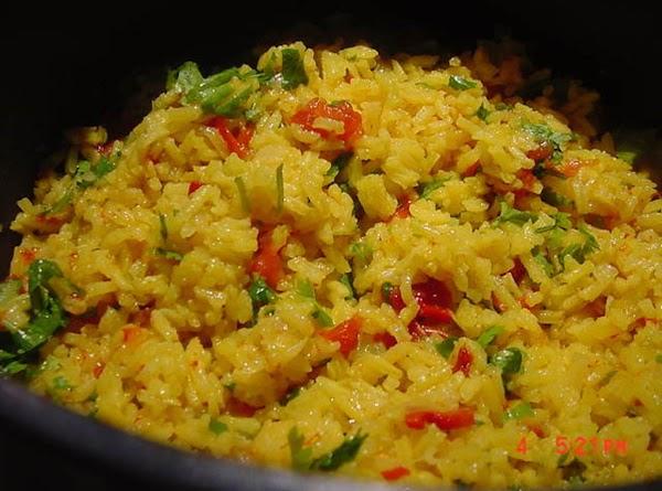 Add tomatoes, turmeric, cumin, salt, garlic powder and water.  Bring to a full...