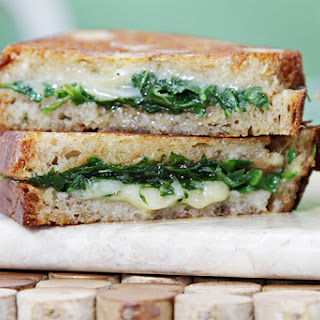 Grilled Cheese Sandwich With Garlic Confit And Arugula.