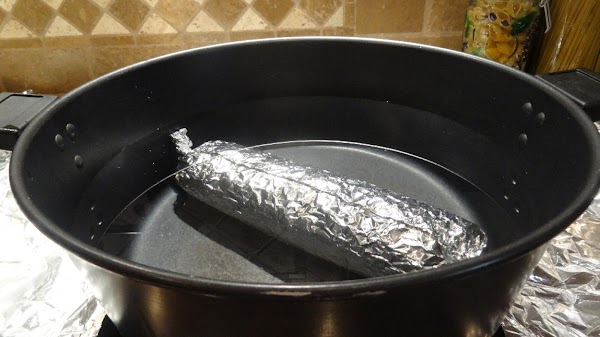 Place the salami in a large deep pan and cover it with water. ...