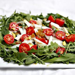 Arugula with Arabic white cheese and pistachio