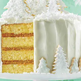 Coconut Cake with Rum Filling and Coconut Ermine Frosting.