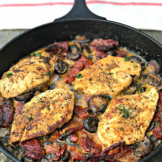 Chicken with Sun-Dried Tomatoes and Mushrooms in White Wine Cream Sauce.