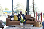 Mamelodi Sundowns coach Pitso Mosimane with the three trophies during the Hyundai Sundowns Lounge: The Road to La Decima Interview Opportunity with Mamelodi Sundowns at Hyundai Head Office on September 14, 2020 in Johannesburg, South Africa.